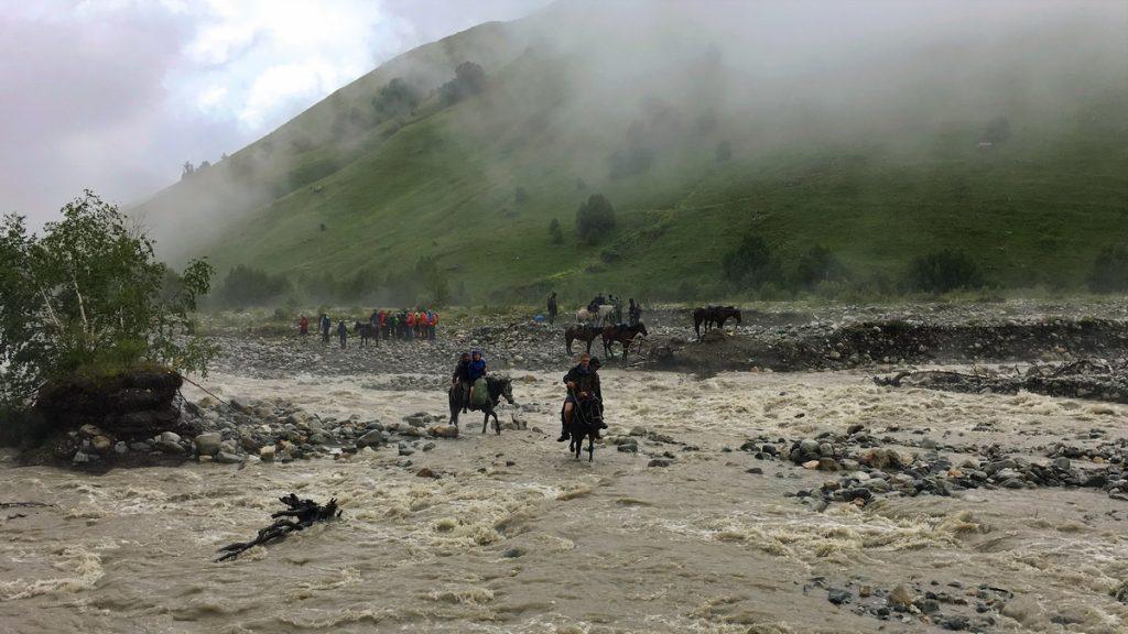 Crossing Adishi river on horse