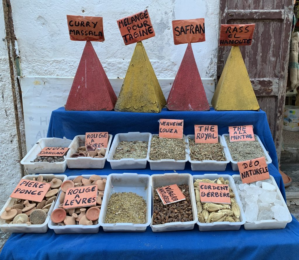 Spices displayed for sale in Essaouria. Part of a post on how to travel gluten free in Morocco
